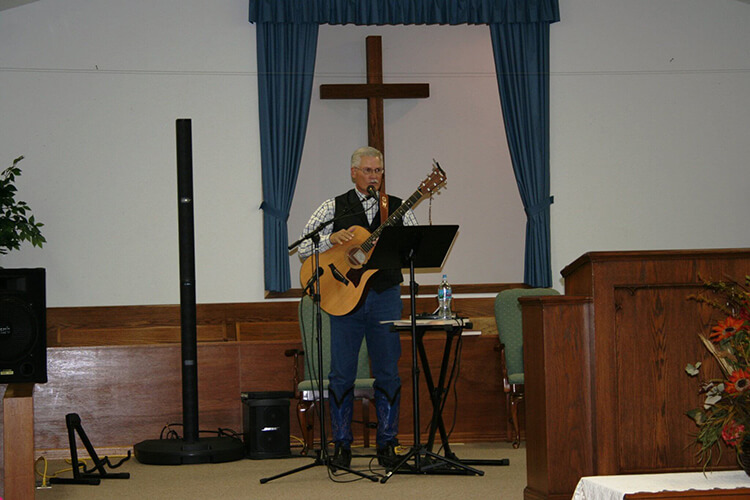 Greg Singing at a Revival