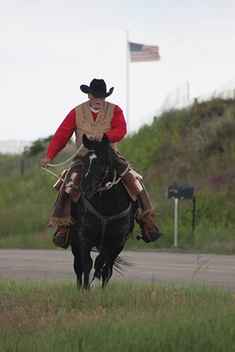 Greg Waggoner on Horseback with the American Flag